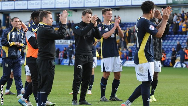 Torquay United's players and staff after their relegation was confirmed at Mansfield