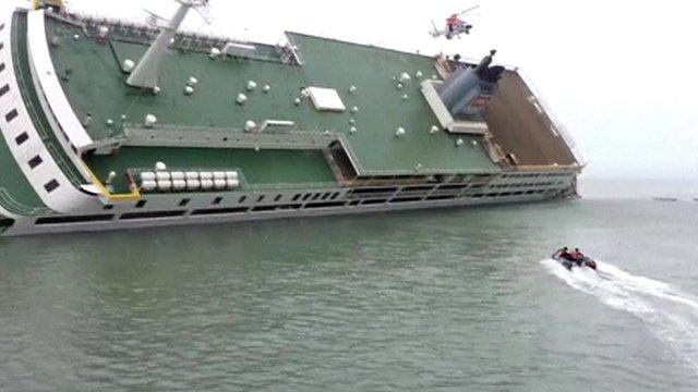 South Korean coastguard approaching the listing ferry