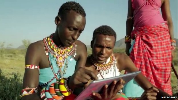 Kenyan villagers accessing the internet