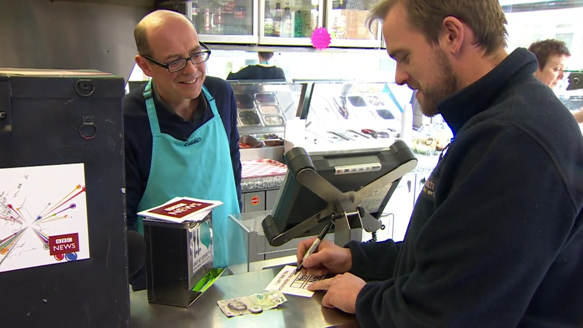 Nick Robinson serves in a fish and chip shop