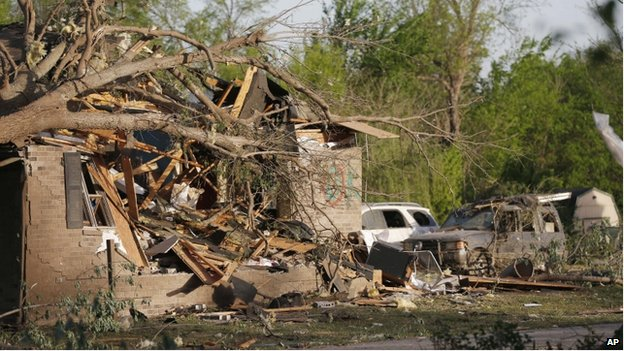 A tornado-damaged home awaits clean up and repairs in Baxter Springs, Kansas on 28 April 2014