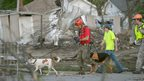 A K-9 rescue unit walks along Military Street in Baxter Springs, Kansas, on 27 April