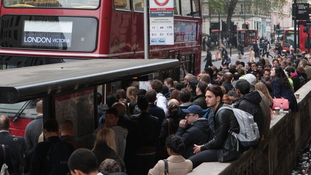 Crowds wait for buses outside Victoria station