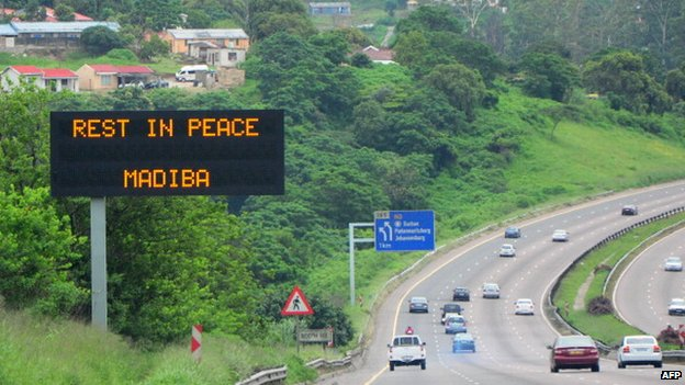 An electronic sign on the side of a road in Durban presents a message in honour of late former South African President Nelson Mandela on the day of his burial on 15 December 2013