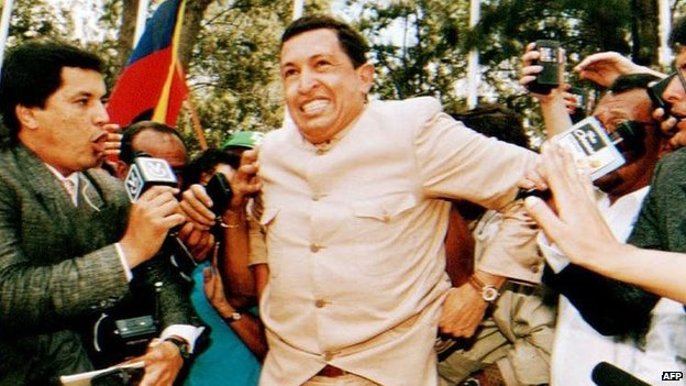 Hugo Chavez talks to reporters on 26 March 1994 after he was freed from jail