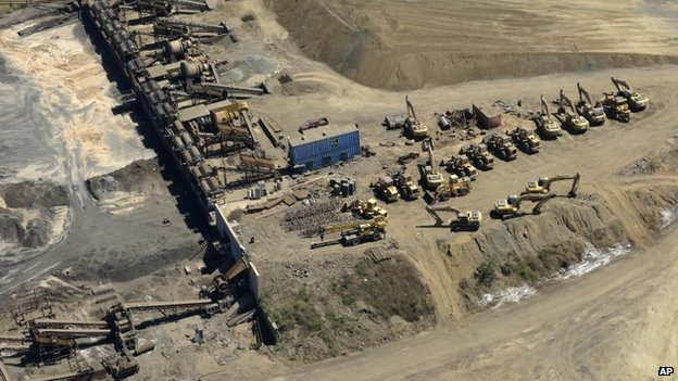 This photo shows a confiscated iron ore mining operation near the Pacific port of Lazaro Cardenas, Mexico (12 March 2014)