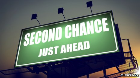Slogan 'Second Chance Just Ahead' on a green billboard
