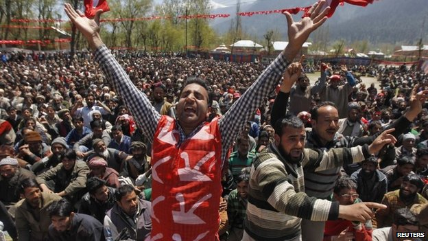 A supporter of Kashmir's ruling National Conference (NC) party, at an election rally being addressed by Farooq Abdullah, the president and a candidate of NC, near Srinagar, on April 28, 2014.