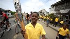 A student from Success Elementary School runs with the Queen's baton in Guyana.