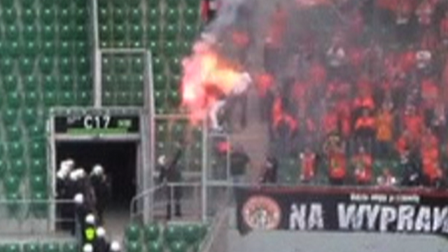 Polish policeman douses flare fan with pepper spray