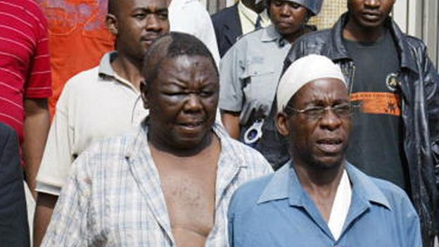 Morgan Tsvangirai (l) leaves the court in Harare on 13 March 2007, after he was arrested and beaten