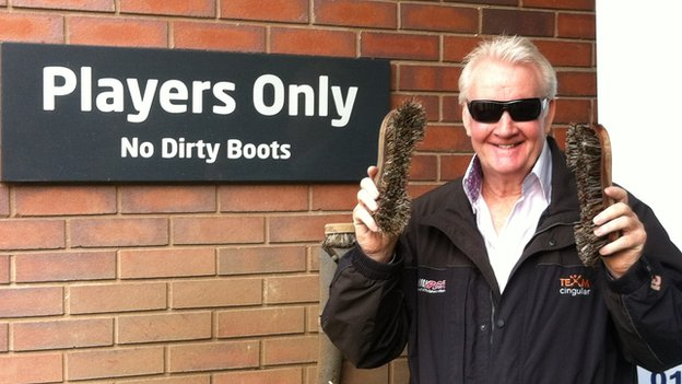 Rodney Marsh holding boot brushes