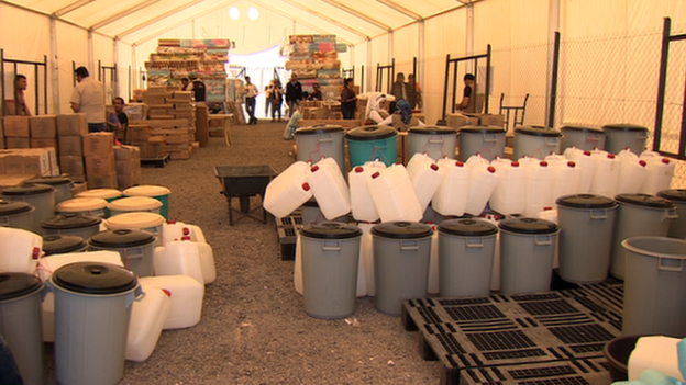 Containers inside shelter in Camp Azraq