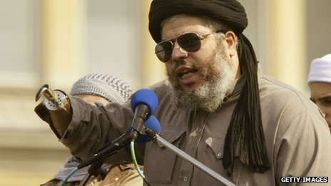 "Abu Hamza, shown speaking in London in 2002,  was known as ""Captain Hook"""