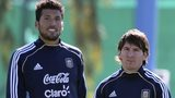 Argentina's Ezekiel Garay and Lionel Messi