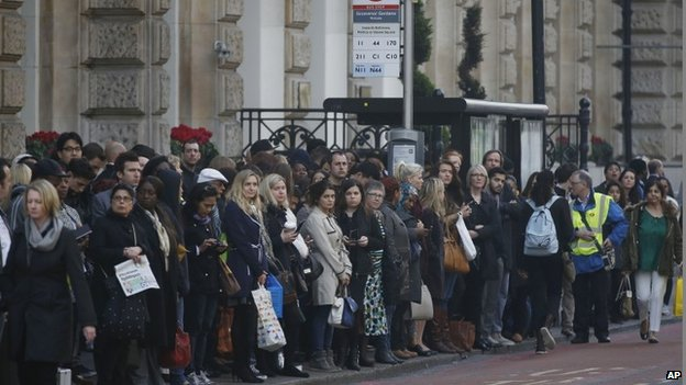 People wait for buses at Victoria Station