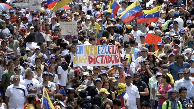 Anti-government activists hold a protest against President Nicolas Maduro in Caracas on 26 April, 2014
