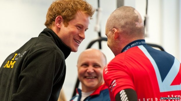 Prince Harry (L) meets veteran Jamie Hull (R) training for the Invctus Games