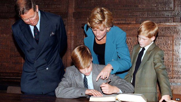 Prince Charles, Princess Diana and Prince Harry watch Prince William sign the Eton College entrance book in September 1995