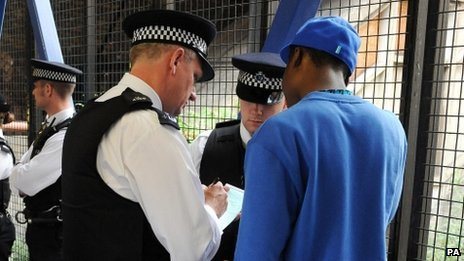 Police officers conduct a stop and search in 2008