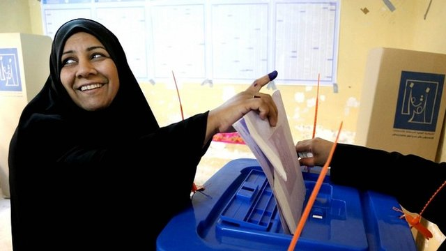 woman votes in Baghdad