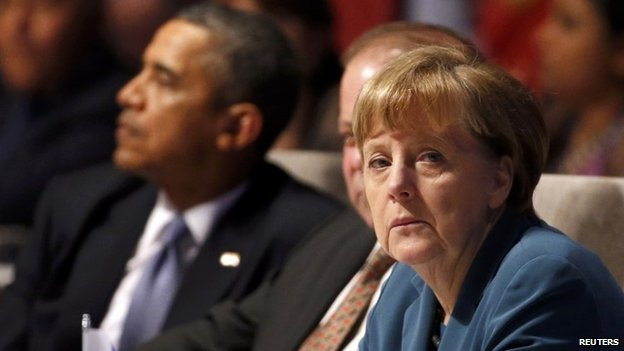 US President Barack Obama,  Germany's Chancellor Angela Merkel (L-R) attend the opening session of the Nuclear Security Summit in The Hague 24 March 2014