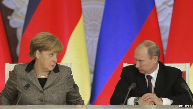 "File photo of Russian President Vladimir Putin (R) and German Chancellor Angela Merkel answering journalists"" questions during a joint news conference in Moscow's Kremlin 16 November 2012"