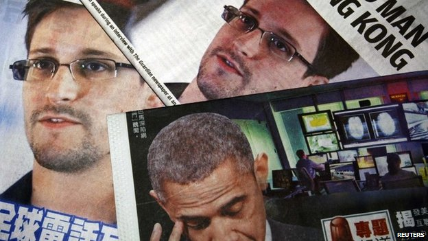 Photos of Edward Snowden, a contractor at the US National Security Agency (NSA), and US President Barack Obama are printed on the front pages of local English and Chinese newspapers in Hong Kong in this file illustration photo taken on 11 June 2013