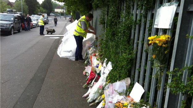Council worker covering up flowers with tarpaulin
