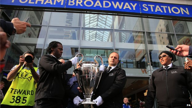 The Champions League trophy at Fulham Broadway Station