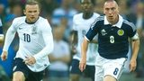 Wayne Rooney and Scott Brown