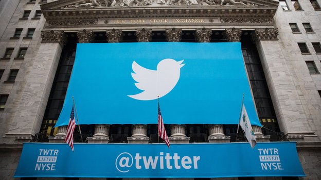 A Twitter banner hangs over the New York Stock Exchange on 7 November, 2013.