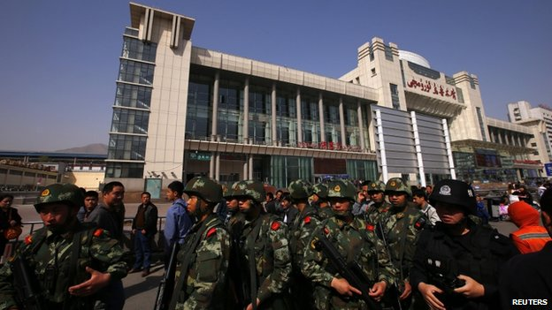 Armed police guard near the exit of the South Railway Station, where three people were killed and 79 wounded in Wednesday's bomb and knife attack, in Urumqi, Xinjiang Uighur Autonomous region, May 2, 2014.