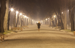 woman walking in park at night