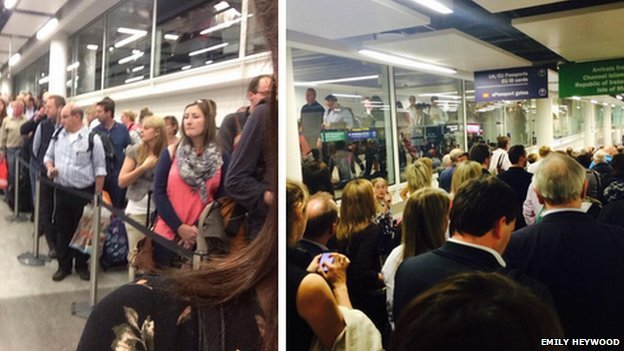 Passengers queue at Gatwick Airport