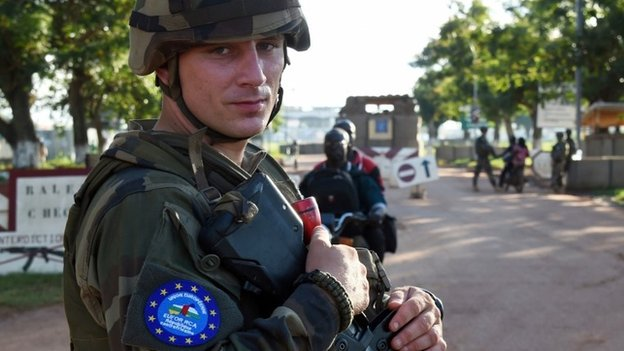 A French soldier of the European Union force stands guard at the entrance of Bangui's airport on 30 April 2014