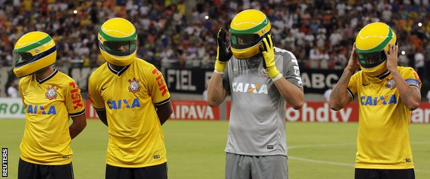 Corinthians players wear replicas of the helmet worn by Senna before the start of their Copa do Brasil match against rival club Nacional
