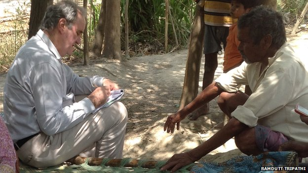 Mark Tully speaks to a villager in Uttar Pradesh