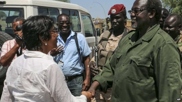 United Nations High Commissioner for Human Rights Navi Pillay (l) shakes hands with South Sudan's former Vice-President Riek Machar