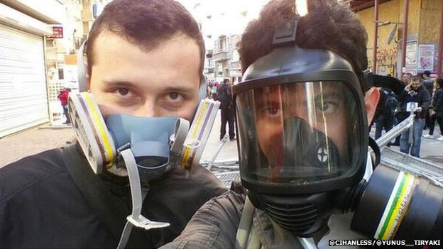 Friends in Istanbul pose in their gas masks