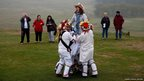 A spectator is lifted by Leicester Morris Men during a fertility dance at Bradgate Park in Newtown Linford, England