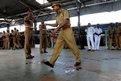 An Indian policeman walks through the scene of a bomb attack in Chennai