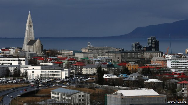 Buildings surround the Hallgrimskirkja church tower in the Icelandic capital Reykjavik on 7 April 2014