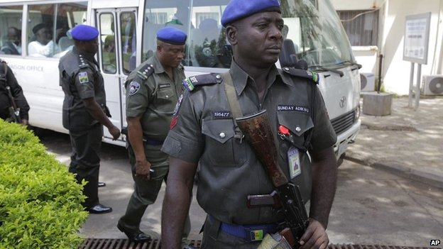 Security men stand guard outside Asokoro hospital in Abuja, Nigeria - April 16 2014