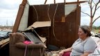 Gloria Burrag sits in the ruins of her home after she road out a tornado April 28 in the kitchen area in Louisville, Mississippi 30 April 2014