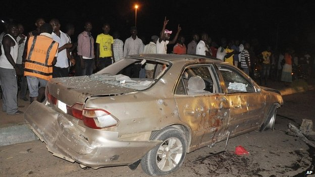 People gather close to the site of the explosion in Abuja, Nigeria - 1 May 2014