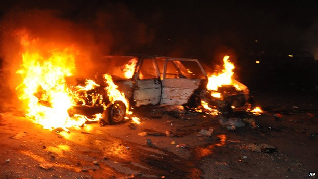 Car burns following a bomb blast in Abuja on 1 May 2014
