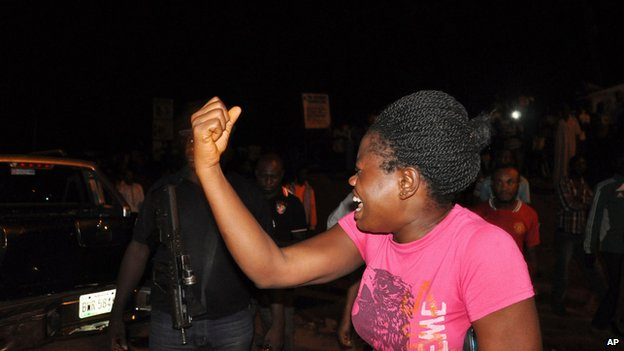 Woman reacts at the scene of the bombing in Abuja on 1 May 2014