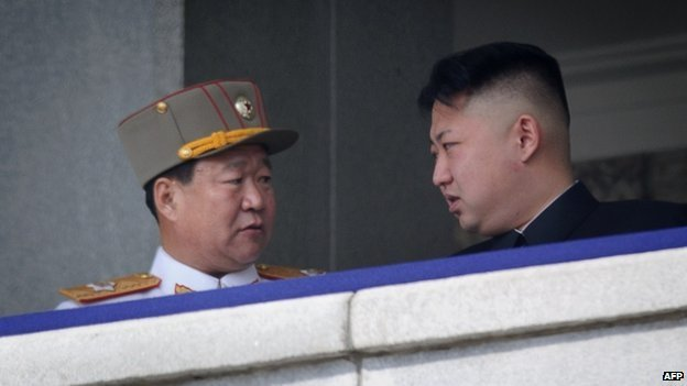Man believed to be Choe Ryong-Hae (L) talking to North Korean leader Kim Jong-Un (R) at a military parade in Pyongyang (15 April 2013)