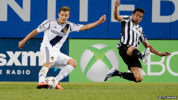 Robbie Rogers (left) playing for LA Galaxy